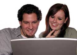 Photo of a couple looking at a computer for online banking