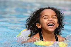 Young girl enjoying swimming in a poll