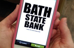 Bath State Bank Mobile App pulled up on a pink cell phone