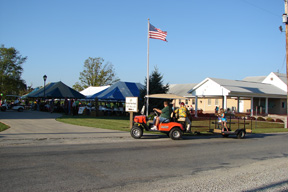 Photo of a golf cart at our Customer Picnic outside the Bank